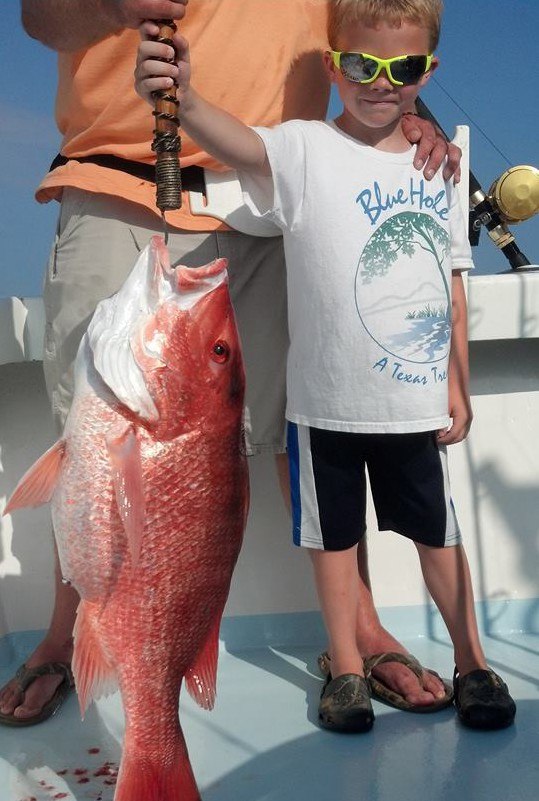 Child with red snapper