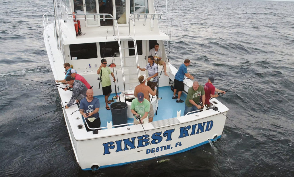 A group of men fishing aboard the Finist Kind Charter Boat